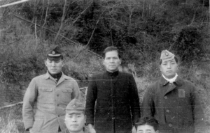The Japanese signalmen, photo taken by someone with bad aim. The man in black was the captain of the oil tanker mentioned earlier.