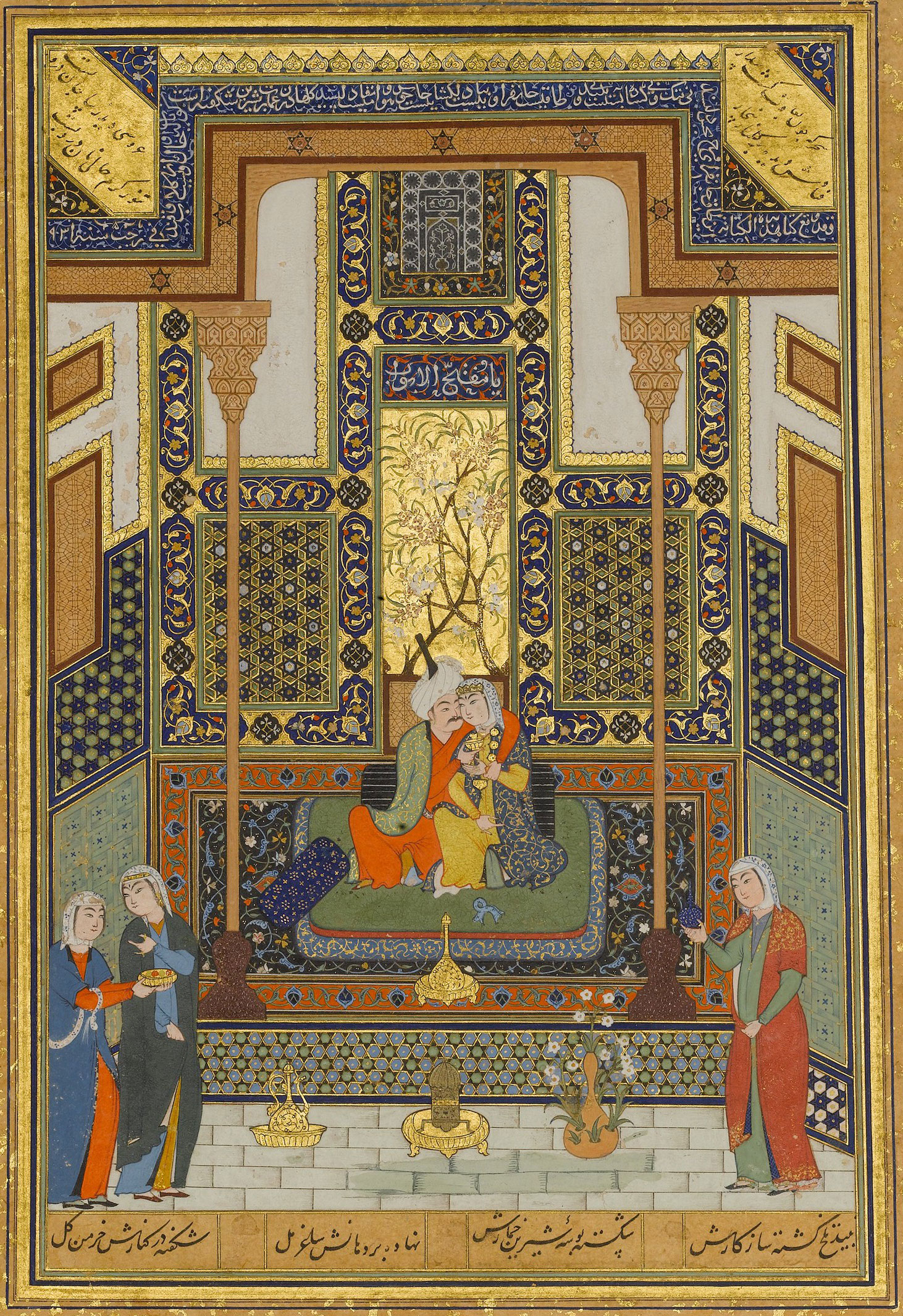The lovebirds seated close together in a pavilion. Three ladies attend them.